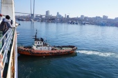 Docking a ferry sideways requires the help from a tugboat