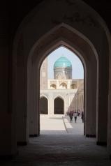 A blue-tiled dome of Mir-I-Arab Medressa as seen from Kalon Mosque