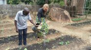 Gitte and Mr. Yona caring for the garden that provides food for the pregnant women.